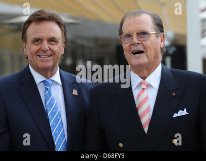 Managing director of Europa PArk Roland mack (L) and British actor Sir Roger Moore pose for the photographers in - Stock Photo
