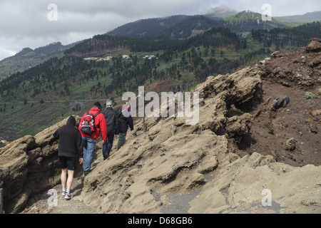 La Palma, Canary Islands - Volcano Park of San Antonio, Fuencaliente, south of island. Visitors on tourist trail. - Stock Photo