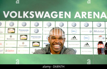 Wolfsburg's new player Naldo laughs during his presentation at a press conference in Wolfsburg, Germany, 19 July - Stock Photo