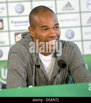 Wolfsburg's new player Naldo smiles during his presentation at a press conference in Wolfsburg, Germany, 19 July - Stock Photo