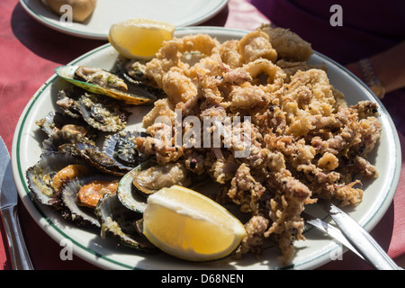 La Palma, Canary Islands - local dishes. Mixed seafood tapas for two, with shellfish and deep-fried octopus. - Stock Photo