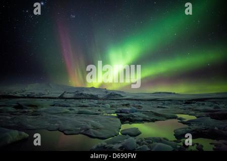 Aurora Borealis or Northern Lighs, over the Jokulsarlon, Iceland - Stock Photo