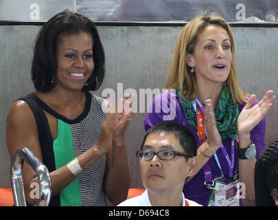 US First Lady Michelle Obama (L) and former US swimmer Summer Sanders attend the swimming competition at the Aquatics - Stock Photo