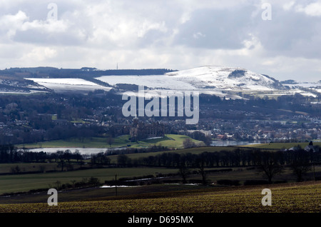 Looking south towards Linlithgow in West Lothian, Scotland with the snow-covered Pentland Hills in the distance. - Stock Photo