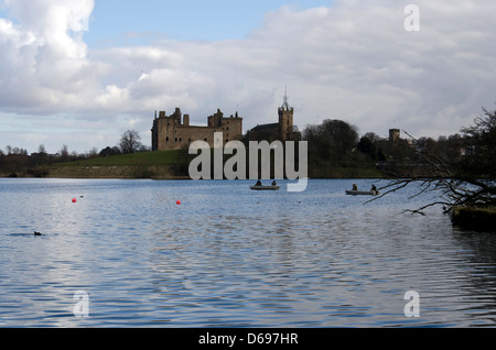 View across Linlithgow Loch towards the Palace and St Michael's Church in West Lothian, Scotland. - Stock Photo