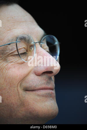President of the European Central Bank (ECB) Mario Draghi smiles with his eyes closed during a press conference - Stock Photo