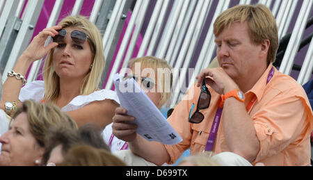 Prince Willem-Alexander of the Netherlands and his wife Maxima during the London 2012 Olympic Games dressage competition - Stock Photo