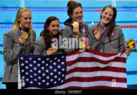 Team USA with swimmers Allison Schmitt, (2-R) Dana Vollmer, (L) Rebecca Soni (2-L) and Missy Franklin (R) celebrate - Stock Photo