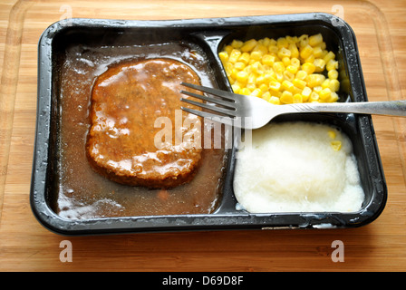 Salisbury Steak TV Dinner with a Fork - Stock Photo