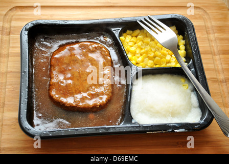 Quick Meal of a TV Dinner with a Fork - Stock Photo
