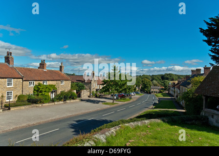 A view down the main street of Coxwold, a pretty village in North Yorkshire - Stock Photo