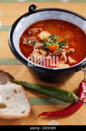 Traditional Hungarian Beef Goulash Soup With Homemade White Bread Stock Photo