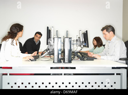 Business people working at desk - Stock Photo