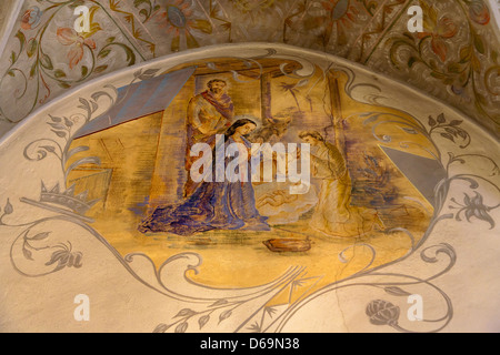 Krakow, Poland, wall painting depicting the birth of Christ in a chapel - Stock Photo