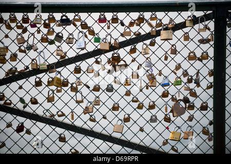 Padlocks on bridge, Paris, France - Stock Photo