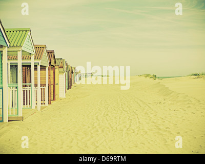 Colorful huts on beach - Stock Photo