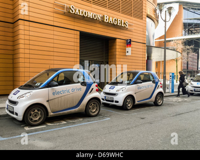 Electric cars charging at a re-fuelling point - Potsdamerplatz, Berlin - Stock Photo