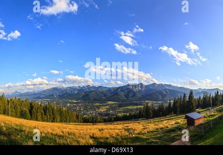 A view of The Tatra Mountains and Zakopane, Poland. - Stock Photo