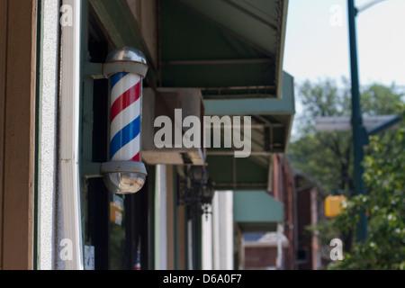 Barber Pole on Main Street - Stock Photo