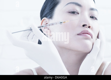 Woman having Botox injection in face