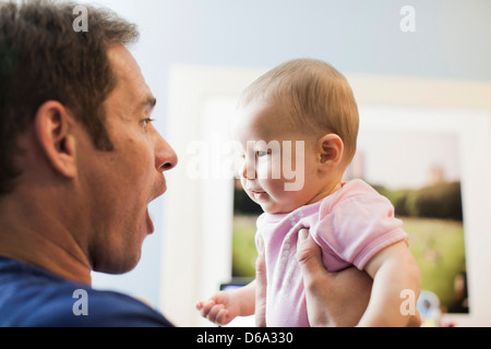 Father holding baby girl - Stock Photo
