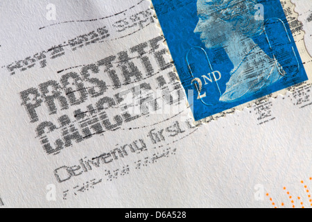 2nd class stamp stuck on envelope and stamped prostate cancer UK delivering first class - Stock Photo