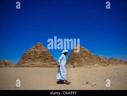 Sudanese Man In Front Of The Royal Pyramids Of Napata, Nuri, Sudan - Stock Photo