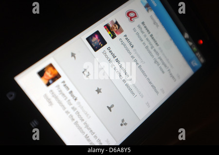 A mobile phone screen showing the tweets following the explosions that hit the Boston Marathon on the 15th April - Stock Photo