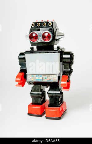 1980's plastic toy robot against a white background. - Stock Photo
