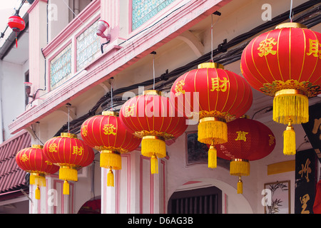 Chinese New Year Red Lanterns with Chinese Text Wishing Good Fortune Hanging on Historic Peranakan Buildings Exterior - Stock Photo