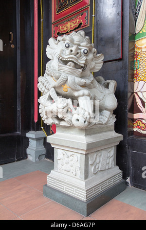 Chinese Foo Dog Temple Female Lion Guardian Marble Stone Sculpture - Stock Photo