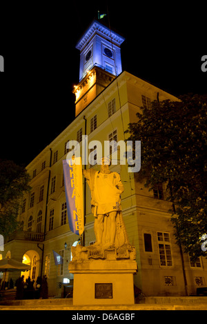 Lviv, Ukraine, the Neptune fountain in front of the town hall on the market square - Stock Photo