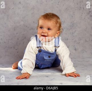 Smiling boy toddler in studio, Winkfield, Berkshire, England, United Kingdom - Stock Photo