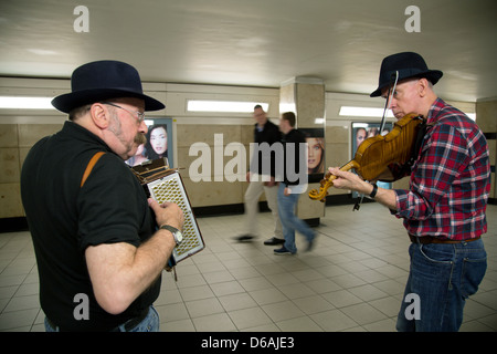 London, United Kingdom, two folk musicians in access to metro station Leicester Square - Stock Photo