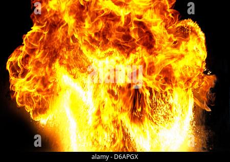 Massive mushroom shaped fire explosion with big flames. - Stock Photo