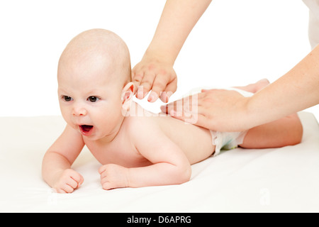 mother massaging her baby boy - Stock Photo