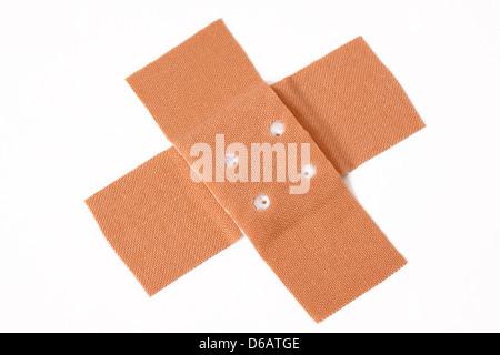 cross,adhesive bandage,plaster - Stock Photo