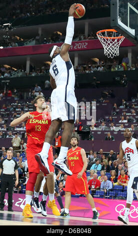 LeBron James of USA (2-L) in action against Marc Gasol (L) of Spain during basketball final game in North Greenwich - Stock Photo