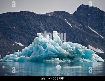 A bizarrely shaped iceberg floats off of the Knud Rasmussen Glacier around 80 kilometers northwest of Tasiilaq in - Stock Photo