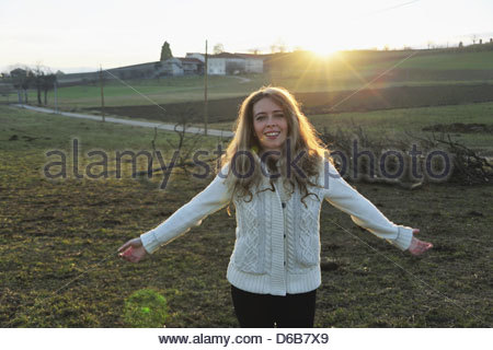 Woman walking in rural field - Stock Photo