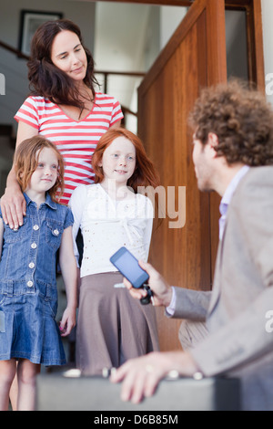 Businessman saying goodbye to family - Stock Photo