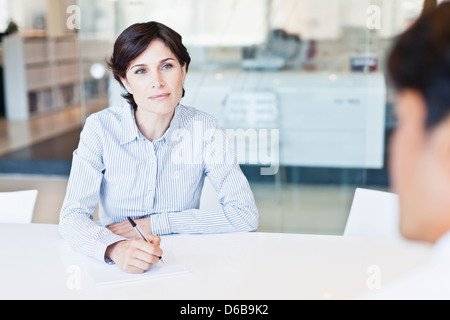 Business people talking at desk - Stock Photo