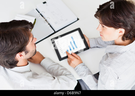 Business people using tablet computer - Stock Photo