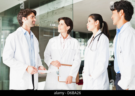 Doctors talking in hallway - Stock Photo