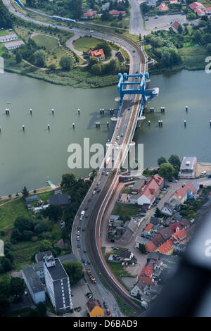 Cars drive over the Peene Bridge in Wolgast, Germany, 21 August 2012. The drawbridge connects Usedom island to the - Stock Photo