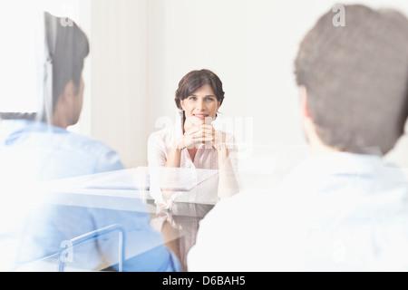 Business people viewed through window - Stock Photo