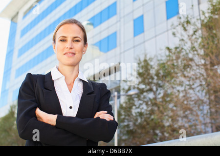 Businesswoman standing on city street - Stock Photo
