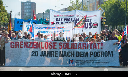 People hold up a banner with the lettering 'Unlimited solidarity' during a demonstration against racism held in - Stock Photo