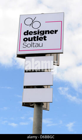 A large sign is pictured at the Designer Outlet Center in Soltau,Germany, 09August 2012. The 80 million euro project - Stock Photo