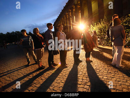 Visitors stand in line in front of the Altes Museum (Old Museum) during the event 'Long Night of Museums' in Berlin, - Stock Photo